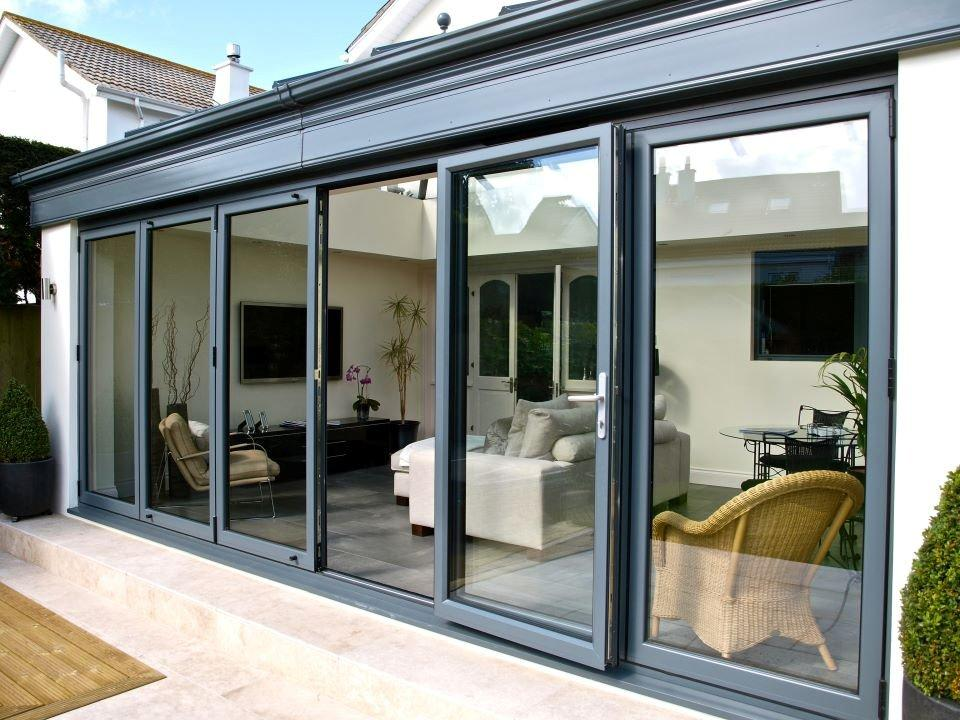 Aliminum bifolds affordable home improvements for Conservatory doors exterior